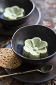 Matcha and coconut panna cotta with sesame seed tuiles