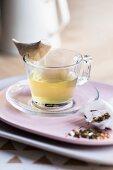 Genmaicha tea in a glass cup
