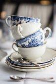 A stack of vintage teacups