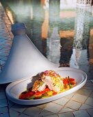 Oriental mink fish tagine with red peppers and beans