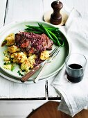 Flat-iron steak with red wine, ginger sauce and crushed potatoes