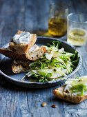 Pear, apple and frise salad with goat s cheese curd toasts