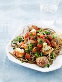 Wholemeal noodles with meatballs, cauliflower and pesto