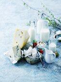 Bottles of milk, quark cream, cream and cheese