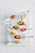 Colourful spoon canapés for a Christmas party