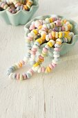 Colourful candy necklaces in china bowls