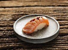 Nigiri sushi with fried salmon and teriyaki sauce