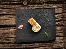 Uramaki with avocado, salmon and sesame seeds
