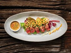 Sushi with beef, vegetables and a spicy dip