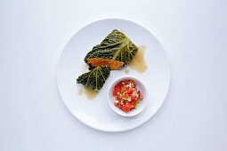 Savoy cabbage roulade with a sweet potato filling and nutmeg flowers