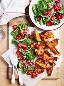 Pesto chicken with baby spinach and roast kumara wedges