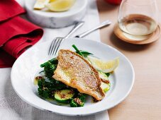 Crispy fish with warm greens