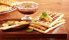 Brussels waffles with fried bananas and chocolate and rum sauce