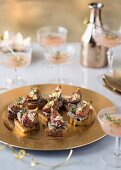 Duck liver pâté with caramelised figs and gold leaf