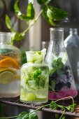 Various summer drinks with fruit, vegetables and herbs