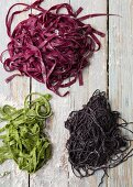 Green pasta with spinach, red pasta with beetroot and black pasta with squid ink