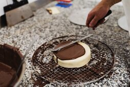 Chocolate being spread with a palette knife