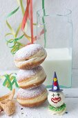 A stack of doughnuts dusted with icing sugar