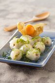 Lychees with honey and lime zest