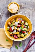 Bread salad with cherry tomatoes and Parmesan cheese