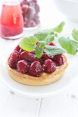 Raspberry tartlet with lemon balm