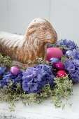 Easter lamb cake in nest of hyacinths and thyme