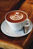 A coffee with a milk foam pattern