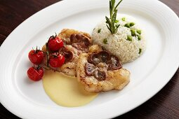 Fried veal kidneys in a mustard sauce with risi bisi (Austria)