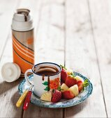 Chopped pineapple and strawberries served with chocolate dip