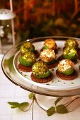 Goats' cheese balls with basil, pistachios and nuts
