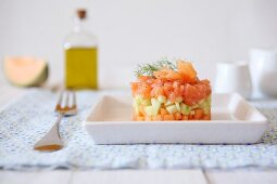 Salmon and cucumber tartare with melon, poppy seeds and dill