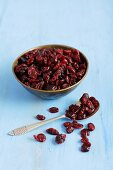 Dried cranberries in a bowl and on a spoon