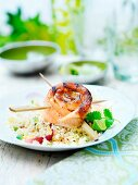 A grilled Cajun-style salmon trout roll with rice