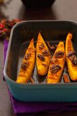 Baked pumpkin wedges with walnuts and cinnamon