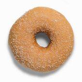 Ein goldbraunes Doughnut mit Zucker
