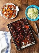 Pork ribs with chilli, fried sweet potatoes and guacamole
