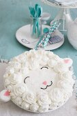 A birthday cake decorated with butter cream for a baby party