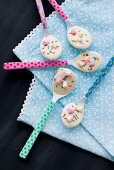 Colourful spoons covered with white chocolate and hundreds and thousand