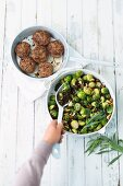 Brussels sprouts with green lentils and nuts served with meatballs