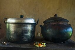 Oriental iron and steel pots on a kitchen counter