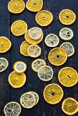 Dried citrus fruit slices on a wooden background
