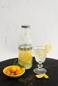 Lemonade in a decorative bottle with a glass