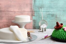 Artistically made cakes with fondant decorations being made