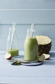 Wheatgrass and pineapple smoothies with apples and avocado
