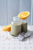 A charcoal smoothie with oranges and bananas