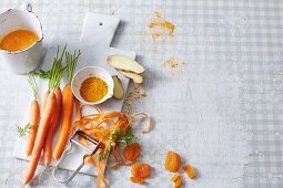 Orange-coloured smoothies being made