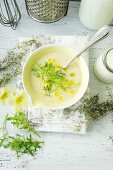 Cream of asparagus soup with rocket