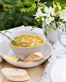 Vegetable soup with pasta, pesto and lemons