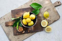 Lemons and almonds on a wooden board