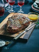 Grilled rib-eye steak with shallot butter